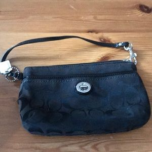 Small Coach wristlet in black